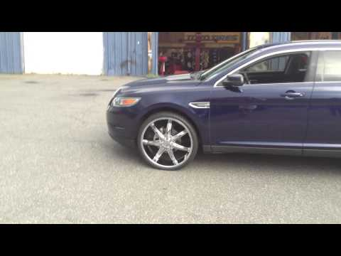 """RimTyme of Charlotte rolling out a Ford Taurus with 24"""" wheels."""