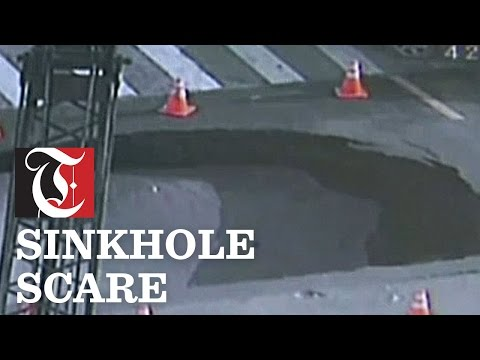 Surveillance video shows a sinkhole appearing