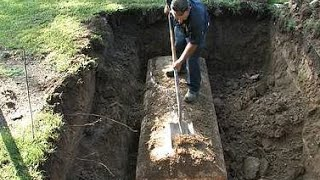 DEAD BODY EXHUMED & EXAMINED IN THE GRAVE