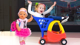 Little girl Nastya and baby doll play fun