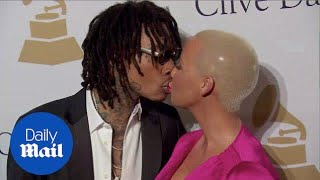 Amber Rose And Ex Wiz Khalifa Kiss At Pre-Grammy Party
