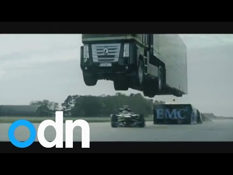 World Record Stunt: Giant Truck Jumps Over Speeding Lotus Racing Car