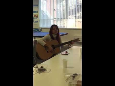 LILA* student Fernanda sings in the Common Room
