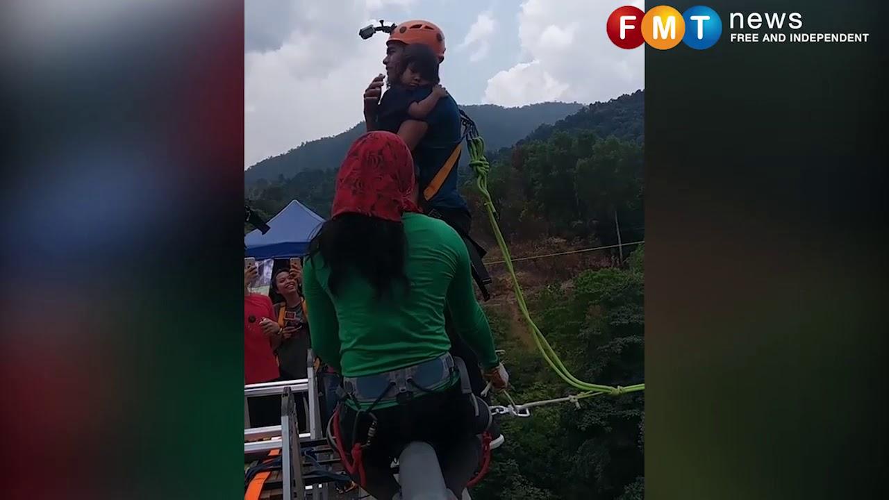 Отец прыгнул с маленькой дочкой на тарзанке с высоты 60 метров
