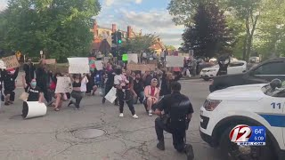 New Bedford police officer joins protesters