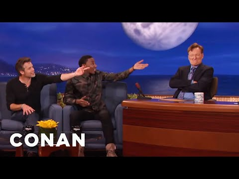 """Play along! TV's a lie."" - Conan introduces an absent Sturgill Simpson, and Timothy Olyphant is up in arms over the whole thing. (CONAN)"