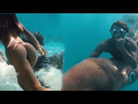 riding-giant-mediterranean-beef-squids-in-bora-bora