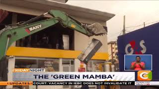 Kenyans hail the green excavator bringing buildings down
