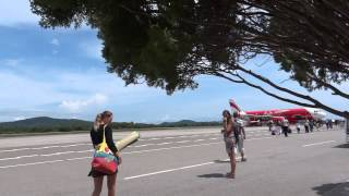preview picture of video 'AirAsia Langkawi airport, walking on the airfield on a plane'