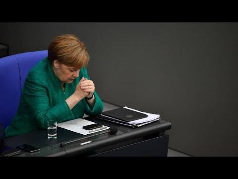Merkel abandons open-door refugee policy to save government