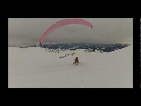 Watch These Lunatics Use Parachutes To Fly Their Snowmobiles Around