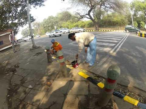 Sidewalk painters in Delhi