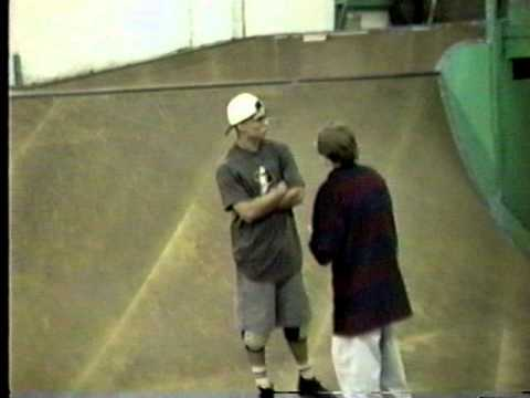 Dudes Fighting in the middle at of the at video cheap skates skate park