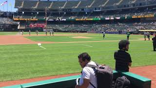 Kirk Vasquez's father throws first pitch at A's game