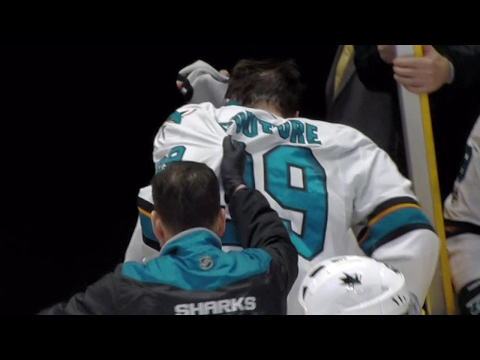 Couture exits after taking deflected Burns shot to face