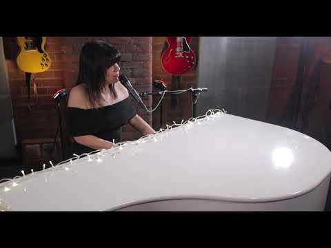Victoria Sharpe plays Romeo and Juliet by Dire Straits on white grand piano
