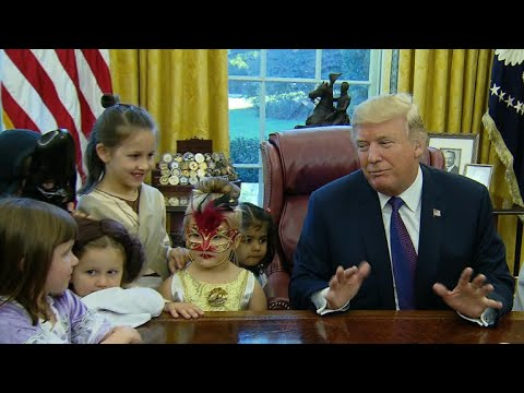 Trump gives treats to costumed kids in Oval Office for Halloween