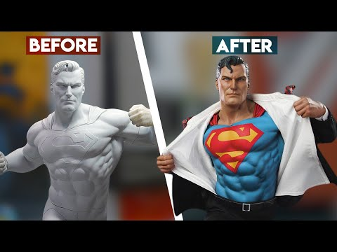 Artist crafting the clothes for a SideShow Collectibles 1/6 Superman toy.