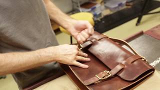 Leather Craftsman Making A Satchel