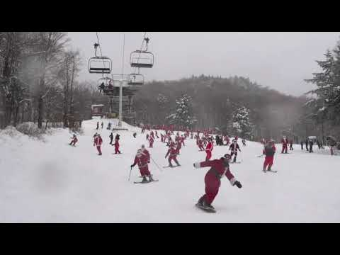 Hundreds of skiing and snowboarding jolly Old St Nicks hit the slopes Sunday in Maine for a good cause. About 300 red-suited lookalikes gathered for the 19th annual Santa Sunday in the tiny western Maine town of Newry. (Dec. 2)