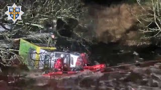 video: Watch: Firefighters rescue delivery driver trapped in floodwater