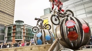 Urban trial riders race through obstacles in Manchester