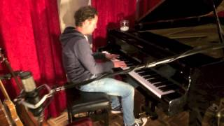 John Denies plays piano at sound vision Studio