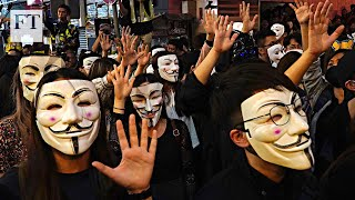Police fire tear gas at Hong Kong protesters challenging face mask ban | FT