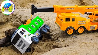 Crane truck pulls dump truck out of deep hole - Kid Studio