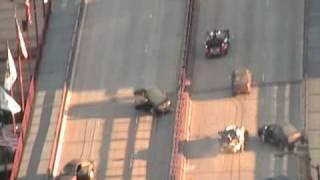 Transformers 3 Chicago Filming - NASCAR cars drive through set (Stunticons?) - VidInfo