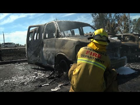 A brushfire burned 86 cars at a CarMax automobile dealership lot in Bakersfield, California. Authorities received reports Monday afternoon of several grass fires erupting along State Route 99 in the Central California city. (June 25)