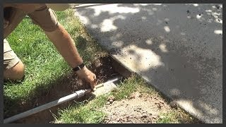 How to install a sprinkler pipe/conduit under a sidewalk