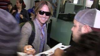 Keith Urban Arrives To Adoring Fans At LAX