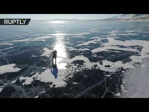 RAW: 76yo Russian grandma commutes on Lake Baikal by ice skates
