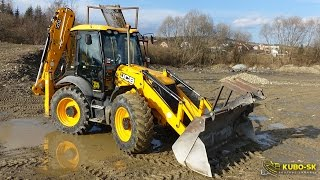 JCB 4CX ECO backhoe loading TATRA truck