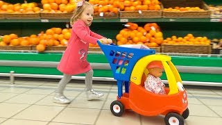 Funny Kid And Baby Doll Lola Doing Shopping