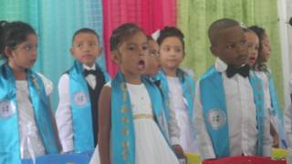 Khailee and friends sing the Belize National Anthem and recite the Pledge to Belize.