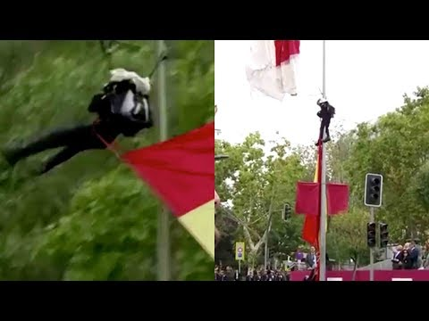 Parachutist Caught on a Lamp Pole During Military Parade