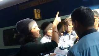 Trying to board a train in India