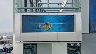 Download Youtube: GLASS SWIMMING POOL 1000 FEET IN THE SKY