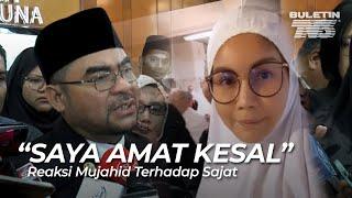 Menteri di Jabatan Perdana Menteri, Datuk Seri Dr Mujahid Yusof menyifatkan tindakan Nur Sajatyang memakai telekung ketika mengerjakan umrah mencemarkan imej Islam dan hubungan baik di antara Malaysia dan Arab Saudi.