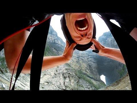 Jeb Corliss flies through Tianmen Cave in China