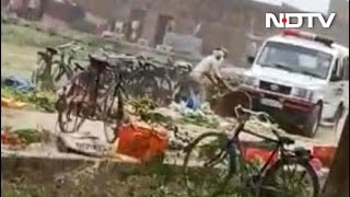 On Camera, UP Cop Crushes Vegetables With Police Car, Reverses Over Them - Download this Video in MP3, M4A, WEBM, MP4, 3GP