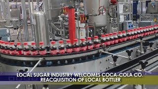 BIZWATCH:  Local Sugar Industry Welcomes Coca Cola Co. Reacquisition of Local Bottler