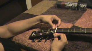 How to attach a strap with string.  (acoustic guitar)