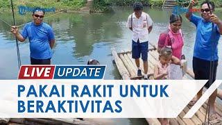 Jembatan Tak Kunjung Dibangun, Warga Lingkungan 2 Bailang Terpaksa Naik Rakit untuk Beraktivitas