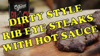 Dirty Rib Eye Steaks with Hot Sauce