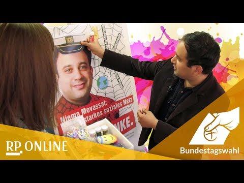 Kapitänsmütze und Glitzerwangen: Niema Movassat (die Linke) verschönert sein Wahlplakat