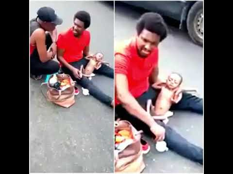Heartbreaking - A Nigerian Father Sitting In The Middle Of The Road Frustrated With His Sick Child