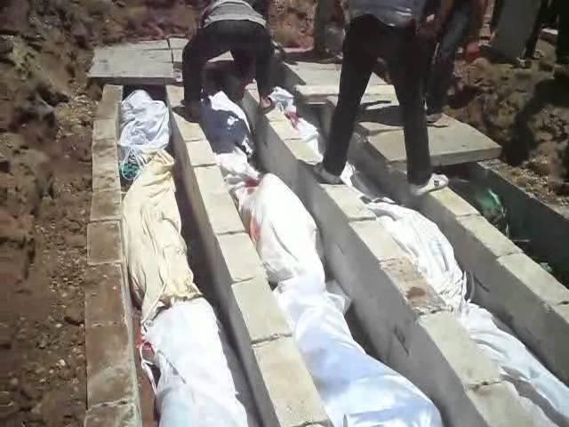 دفن ضحايا مجزرة الحولة